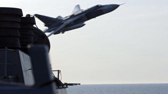 Russian warplanes flew simulated attack near a U.S. missile destroyer
